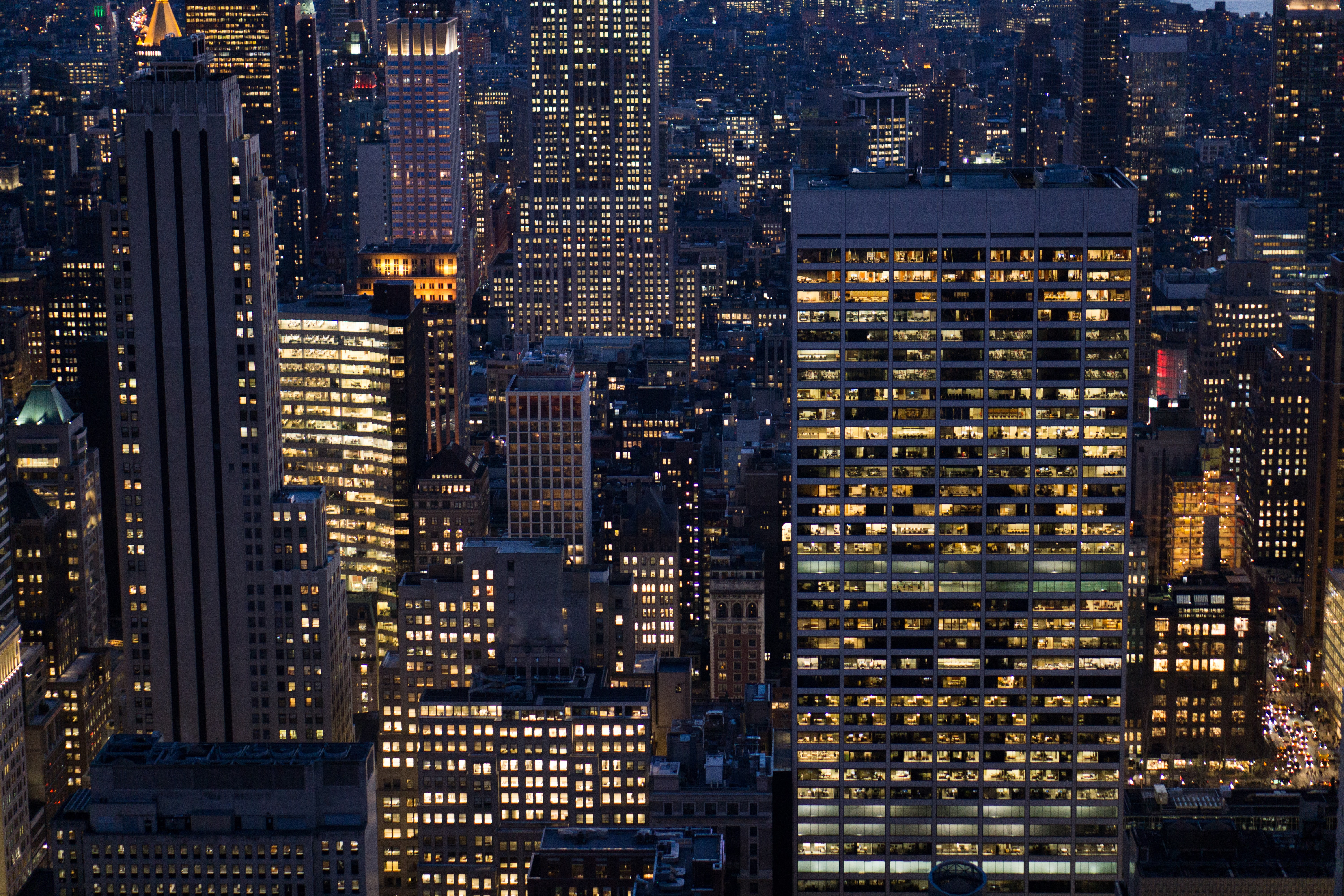aerial photo of a lighted city buildings
