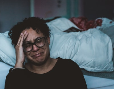 person crying beside bed emotion zoom background