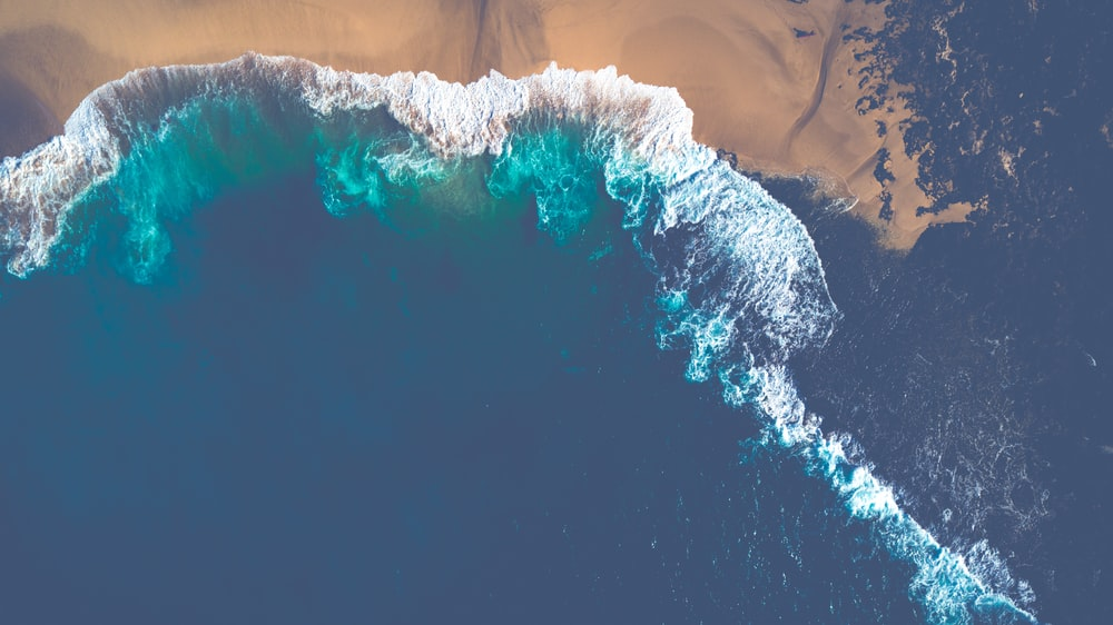aerial view of ocean wave during daytime
