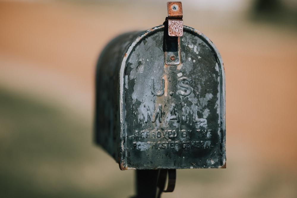 closeup photography of black U.S. mailbox