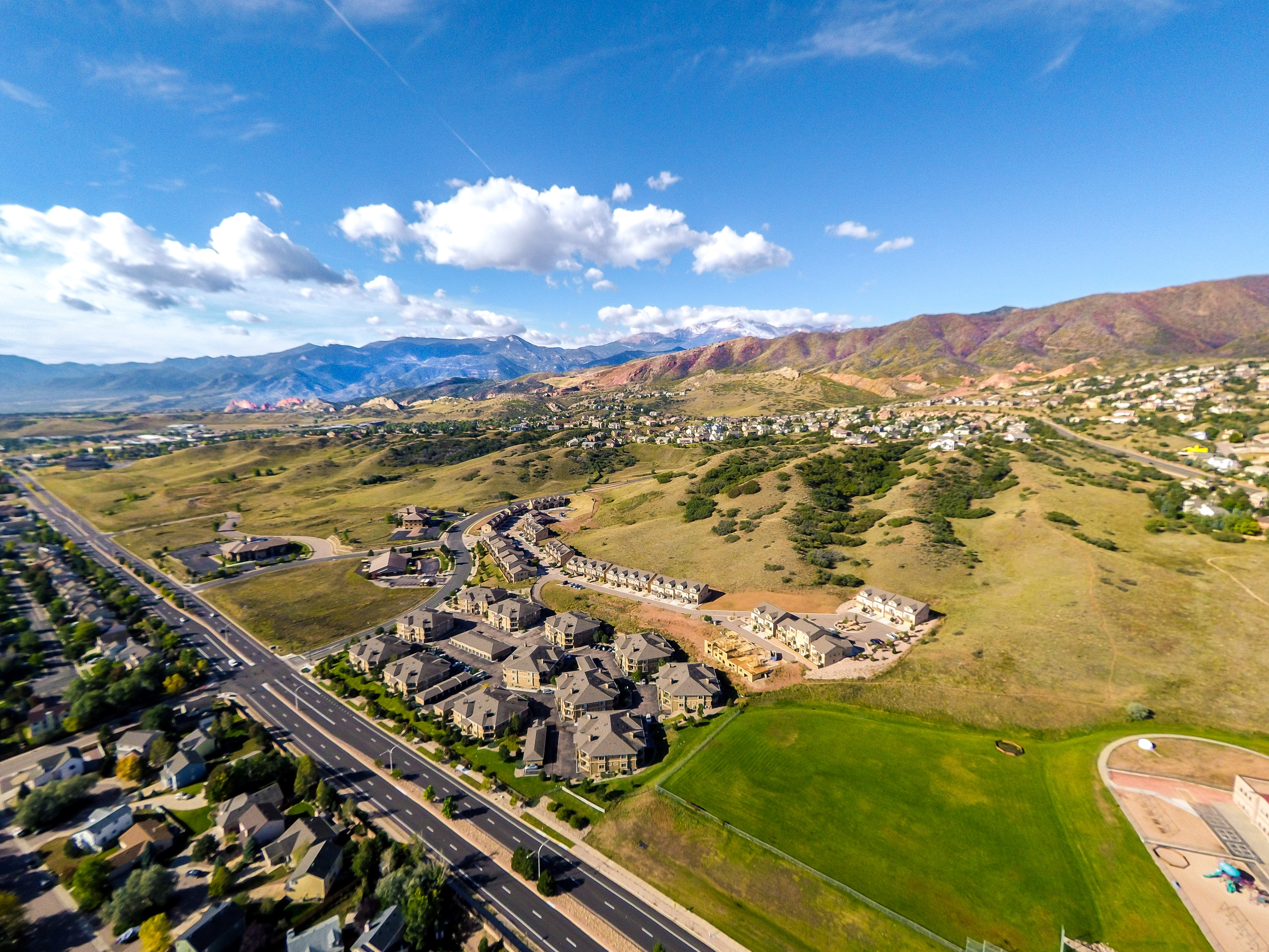 aerial photography of houses near mountain