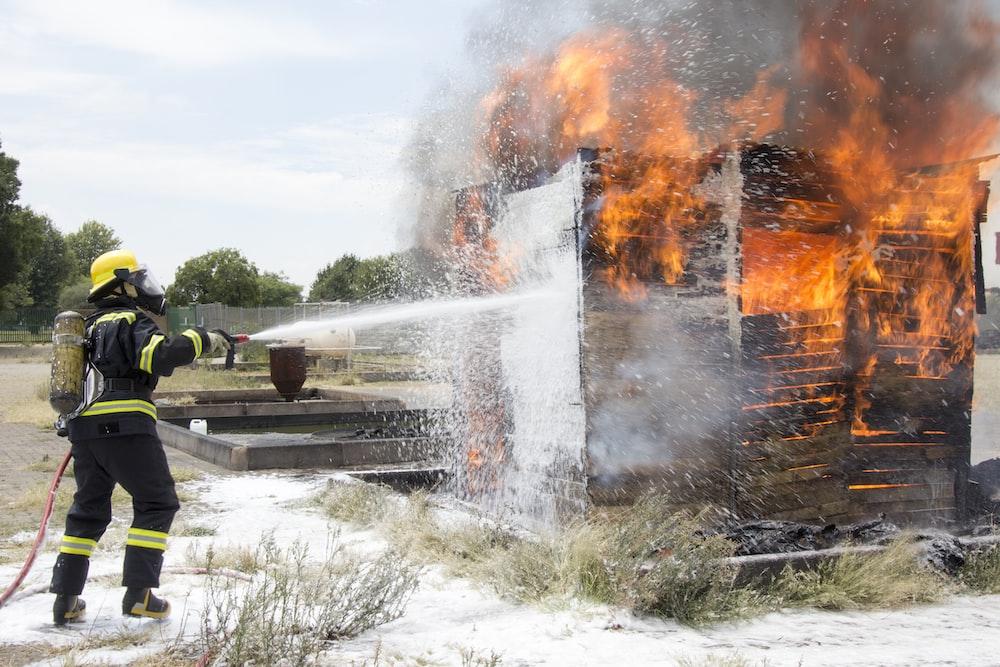 fireman extinguishing the burning house