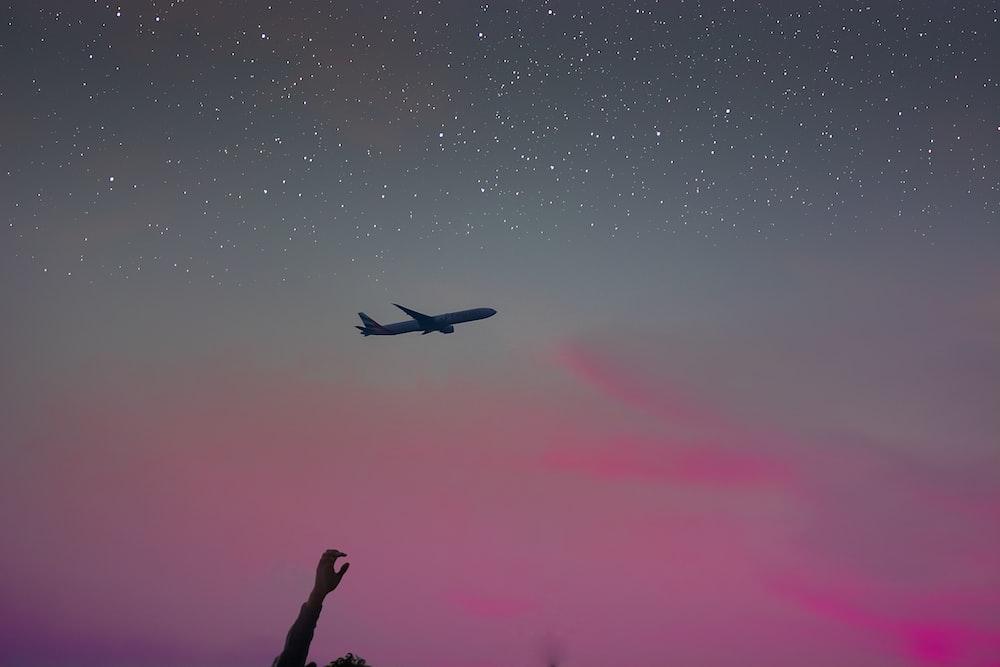 passenger plane flying on sky