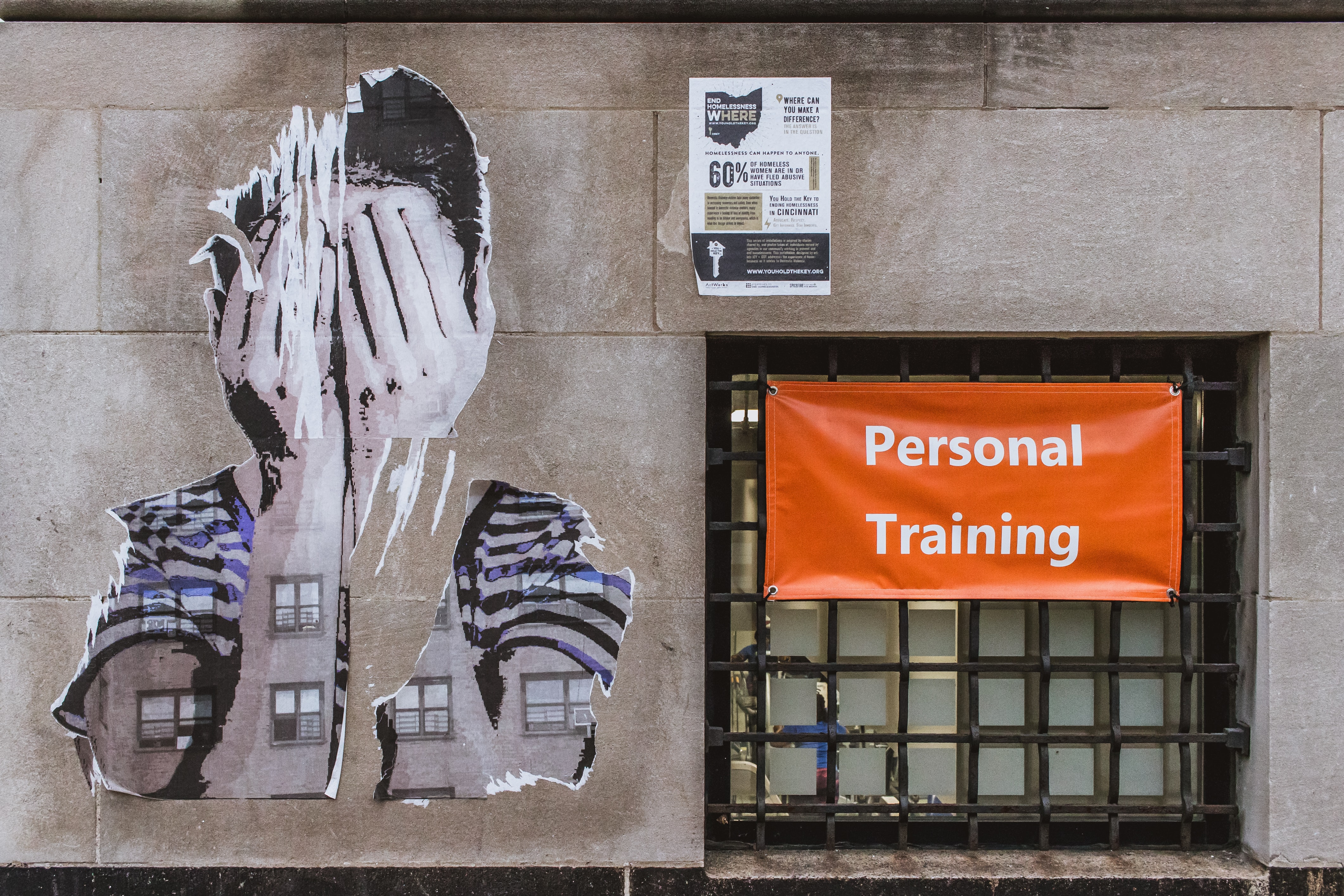 person covering face wall painting