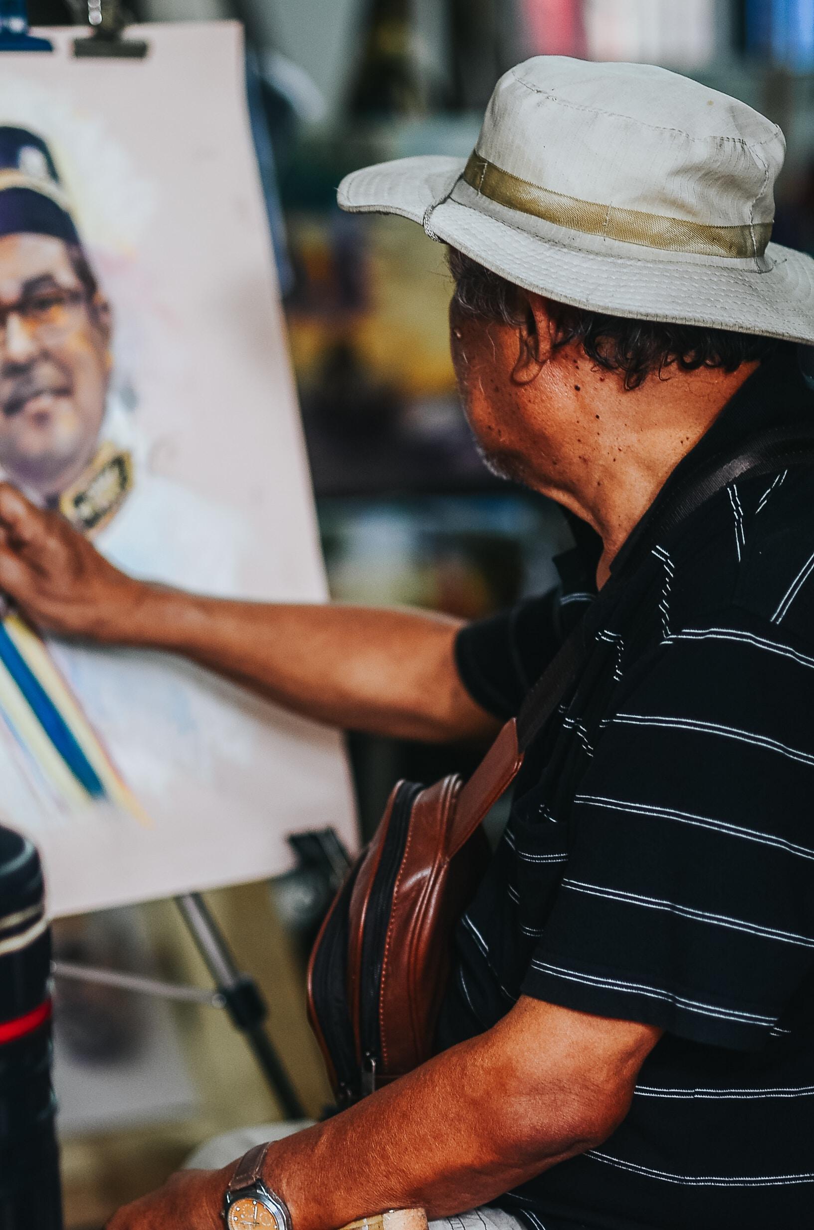 man painting portrait