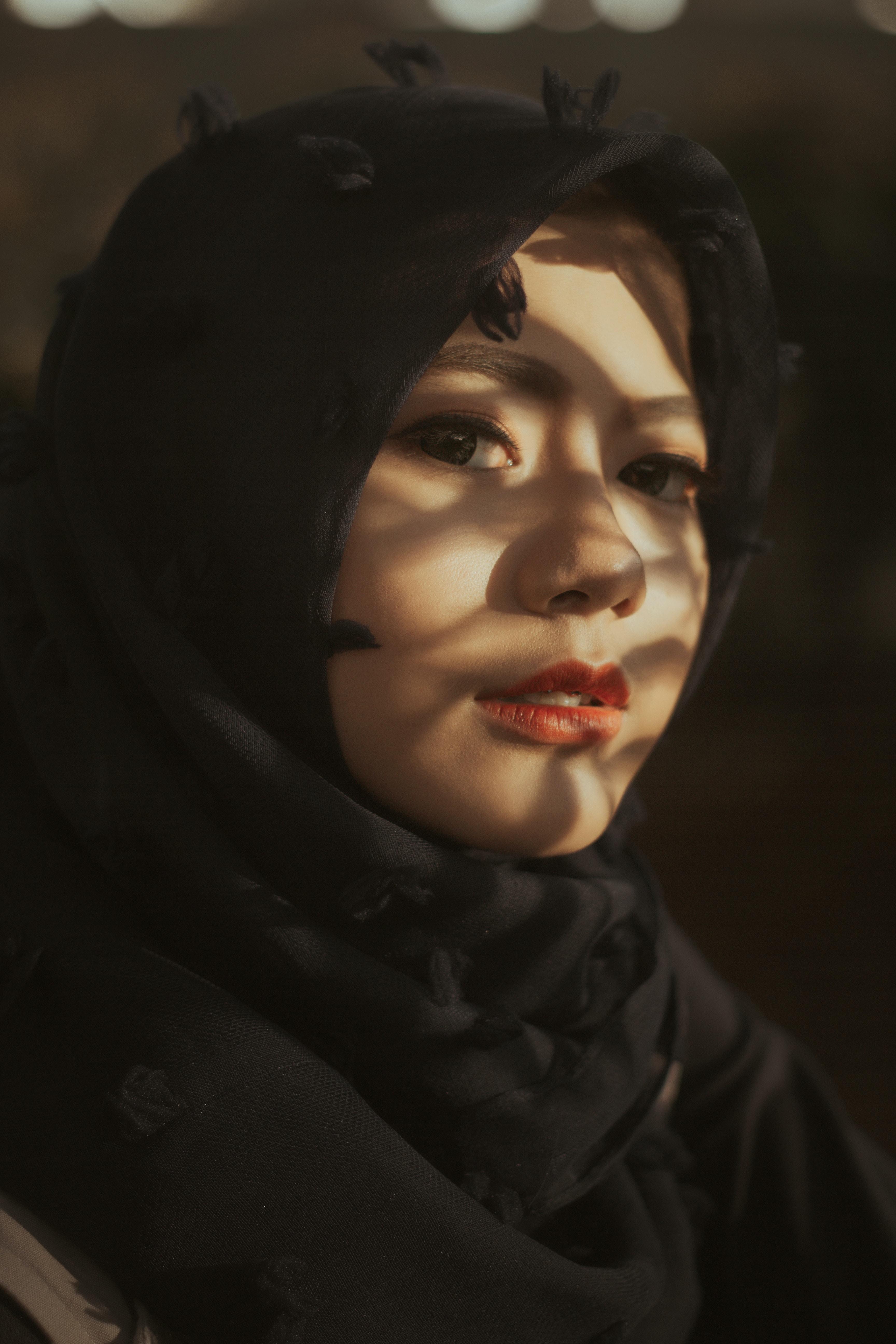 woman wearing black headscarf taking selfie