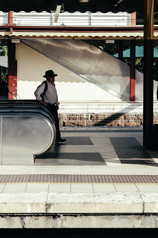 man beside escalator