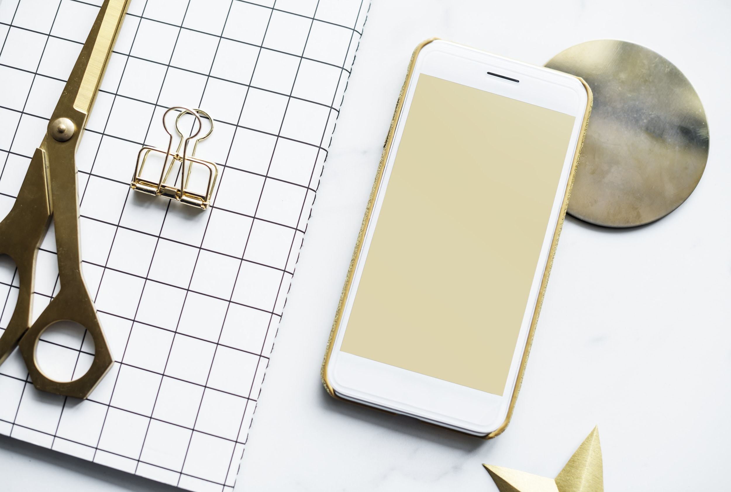 white Android smartphone beside of scissors