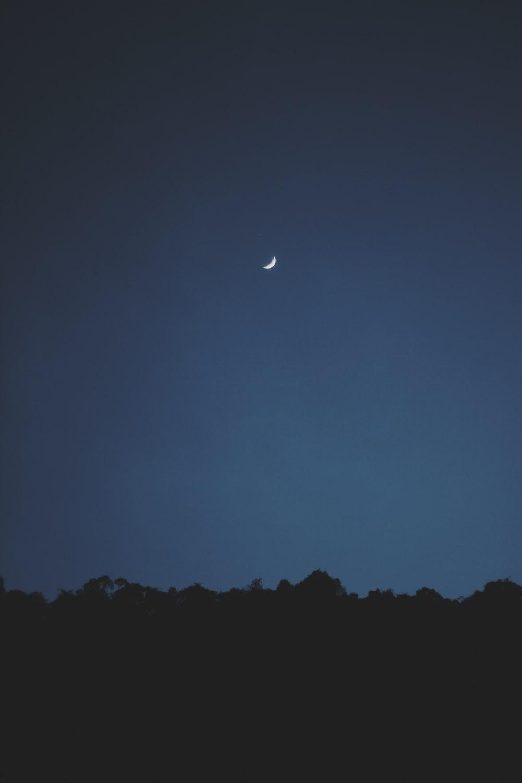 half-moon during nighttime