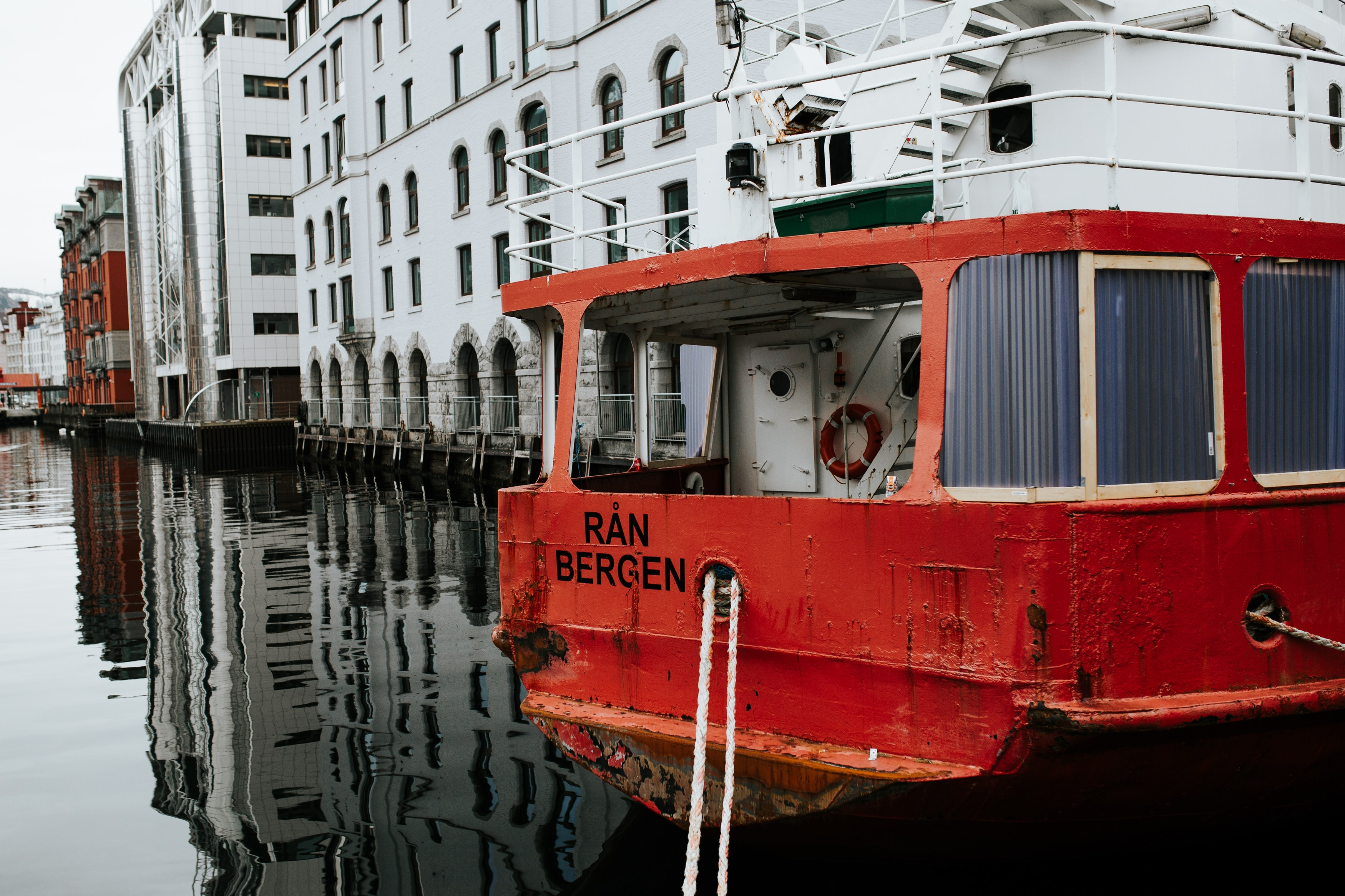 red boat near white building