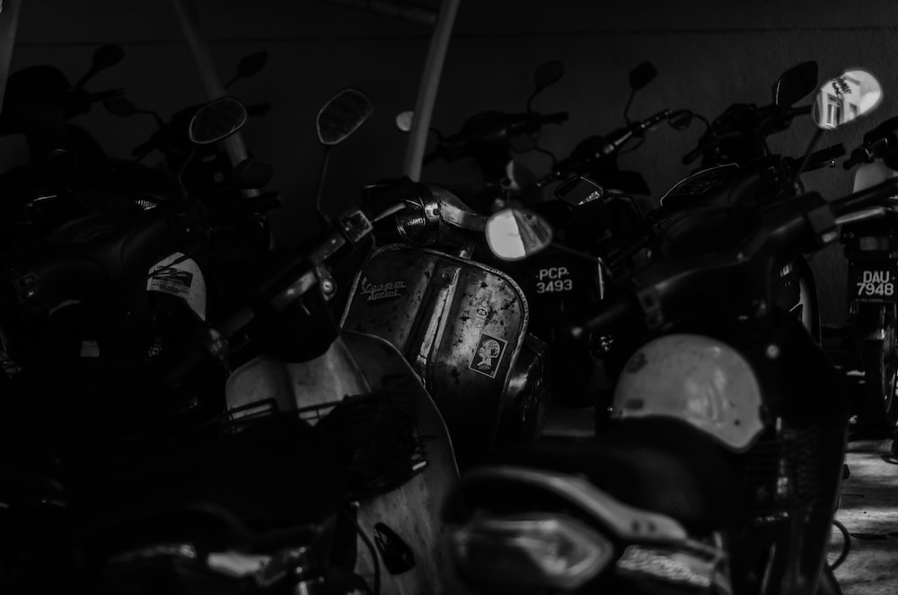 grayscale photography of motor scooters