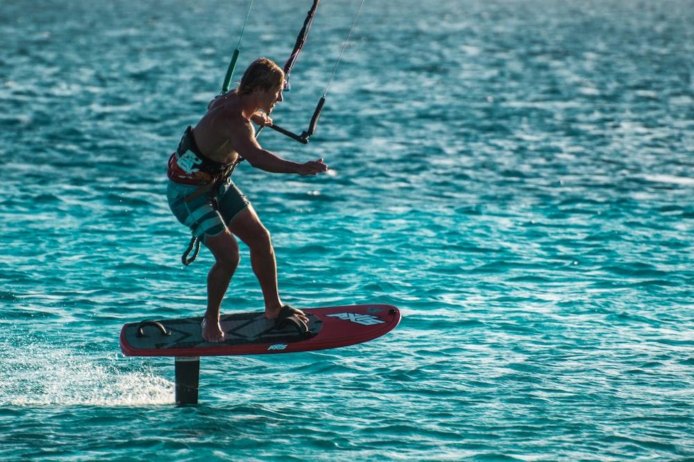 man wake boarding on water