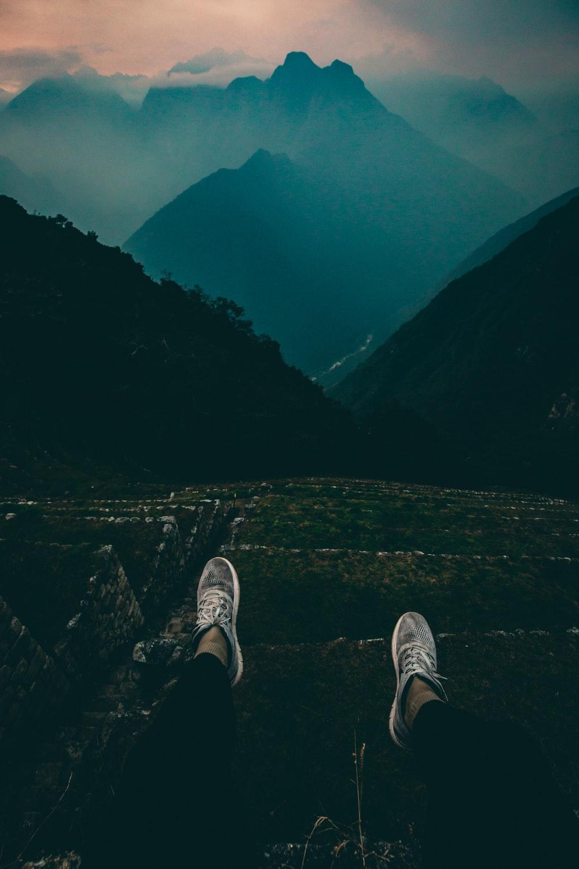person standing on mountain peak