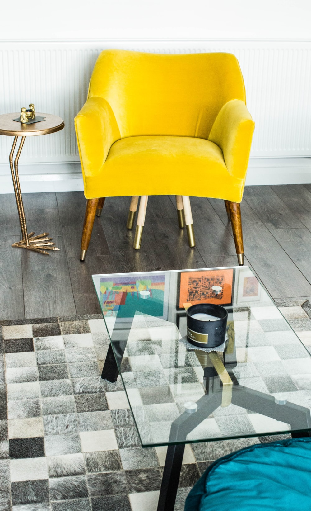 yellow suede armchair beside side table
