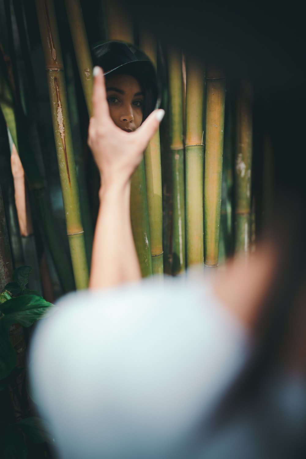 woman surrounded with bamboo sticks