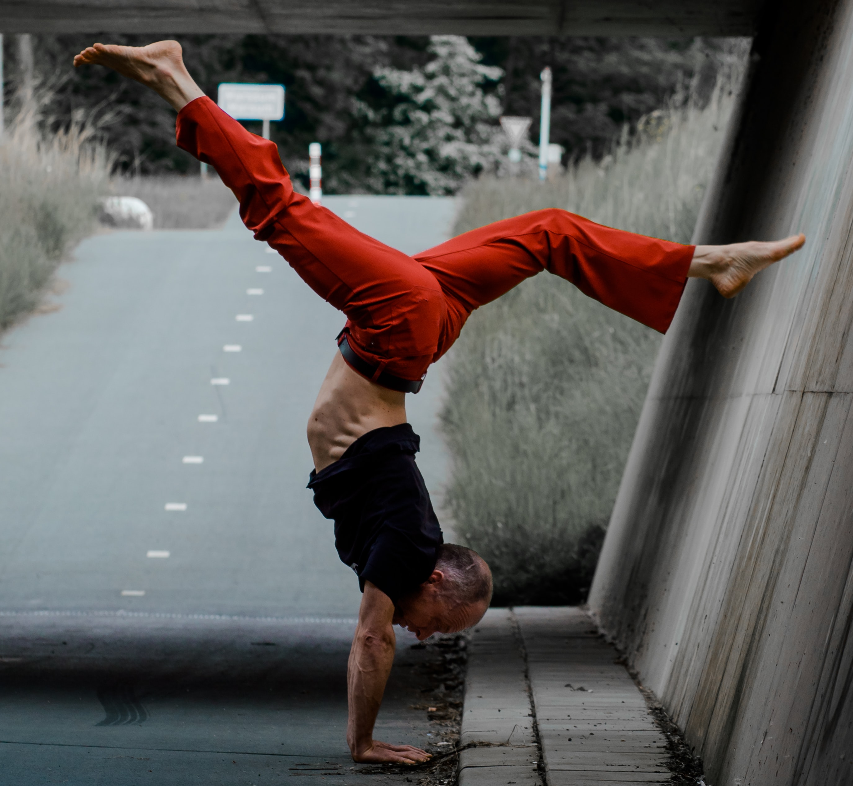 man using hand stand