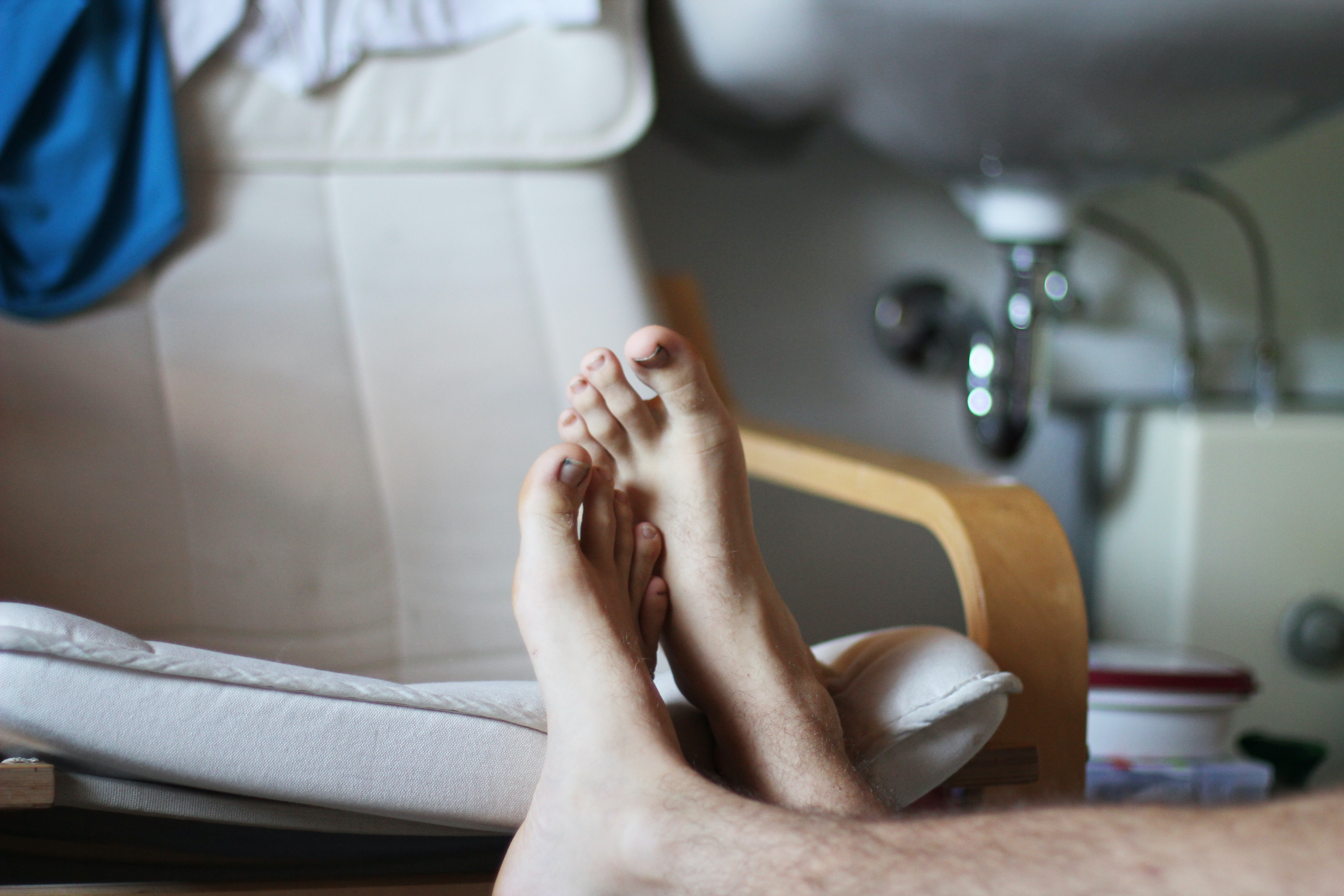 persons foot near glider chair