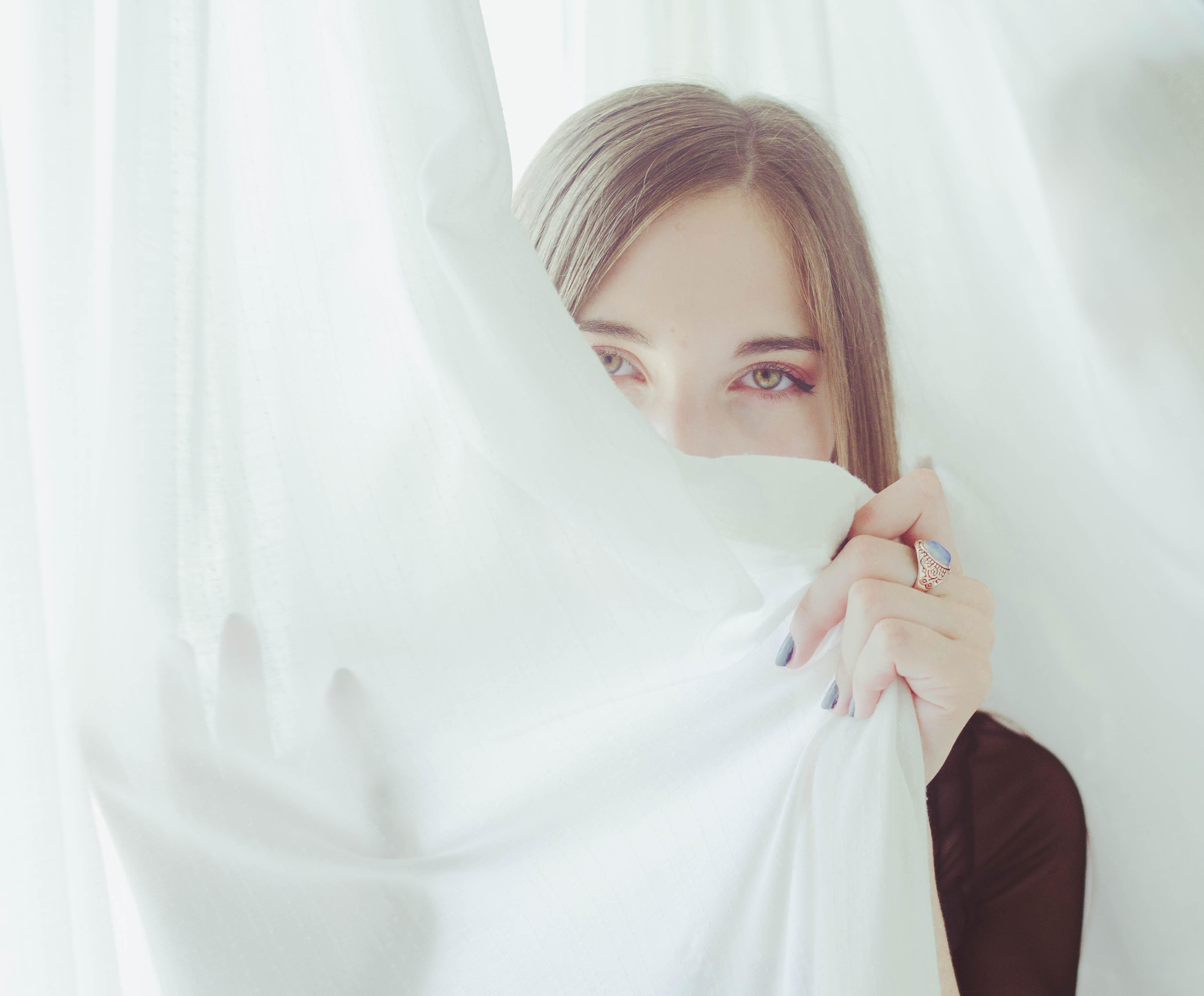 woman hiding on cloth