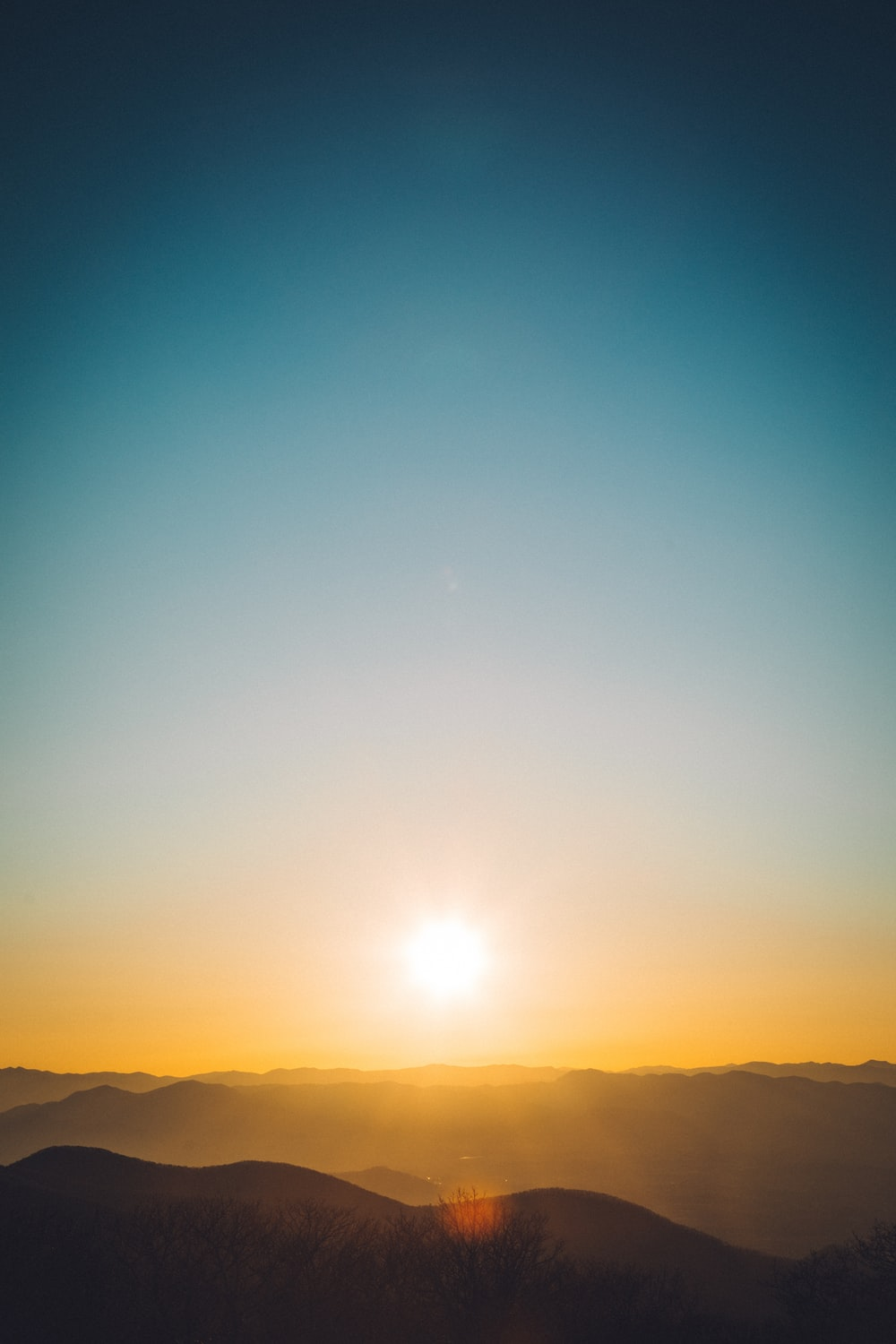 silhouette of hills at golden hour