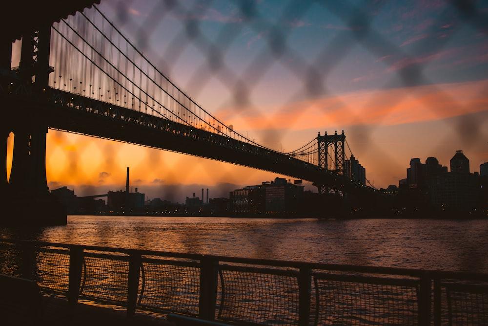 bottom view of black Brooklyn bridge