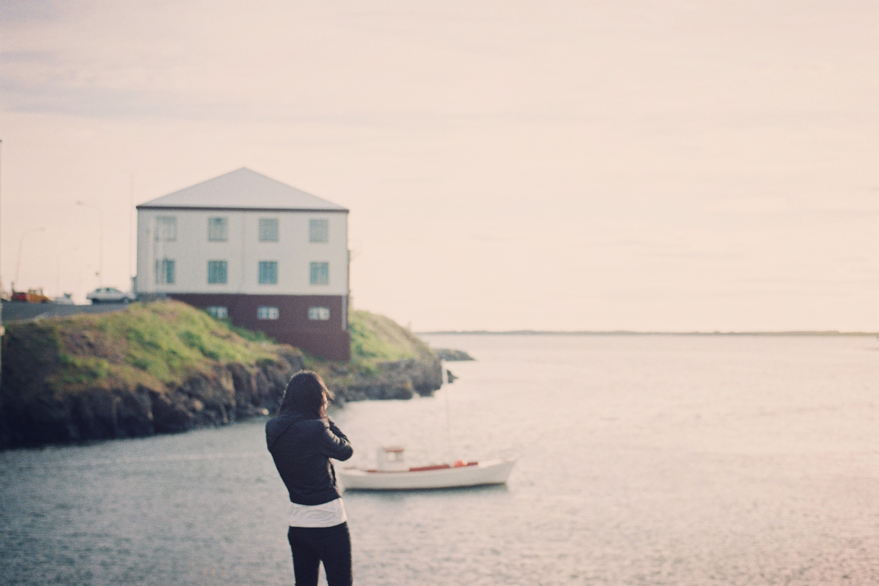 woman standing near body of water w