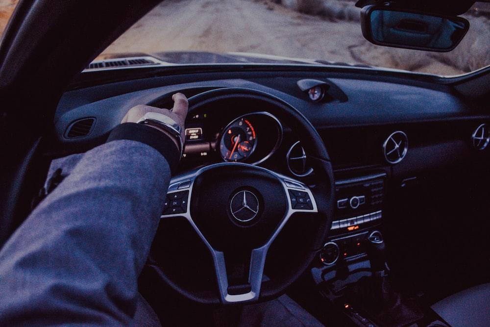 person driving Mercedes-Benz car