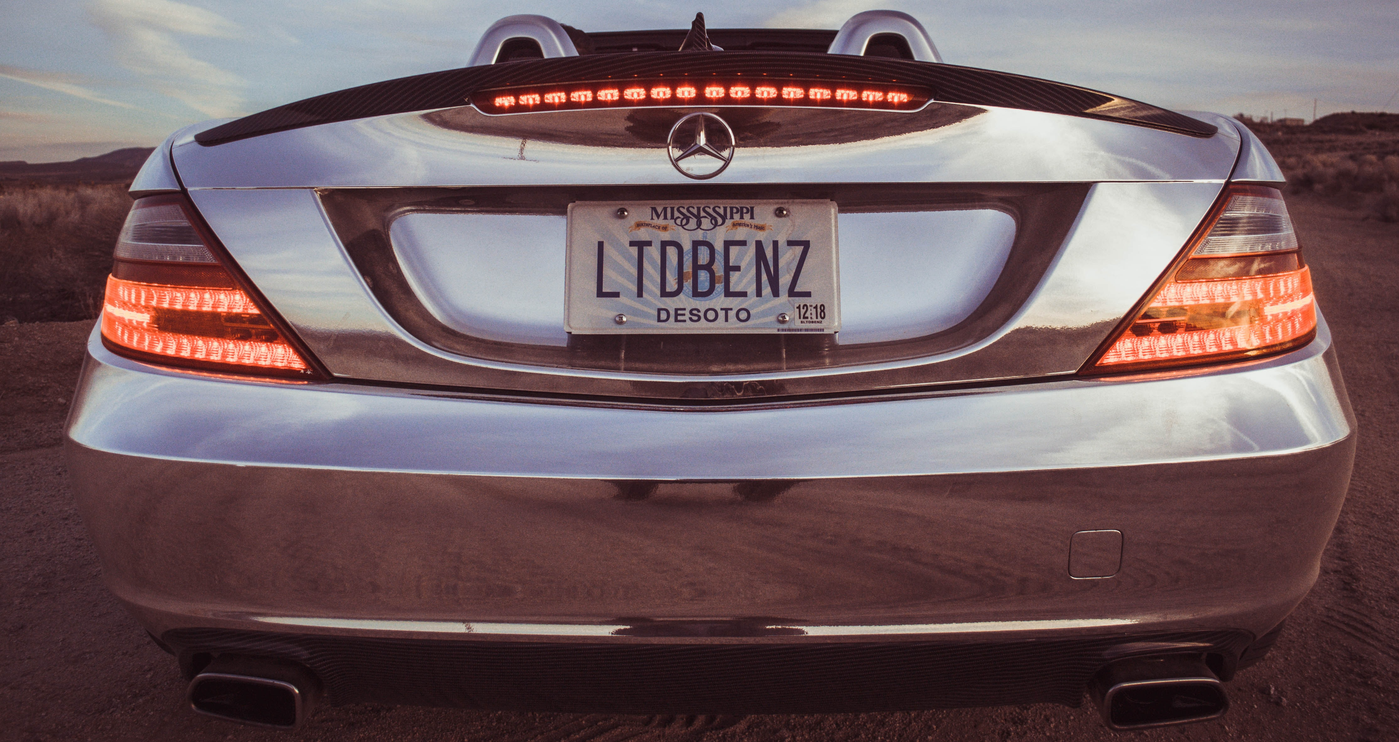 silver Mercedes-Benz car with LTDBENZ license plate