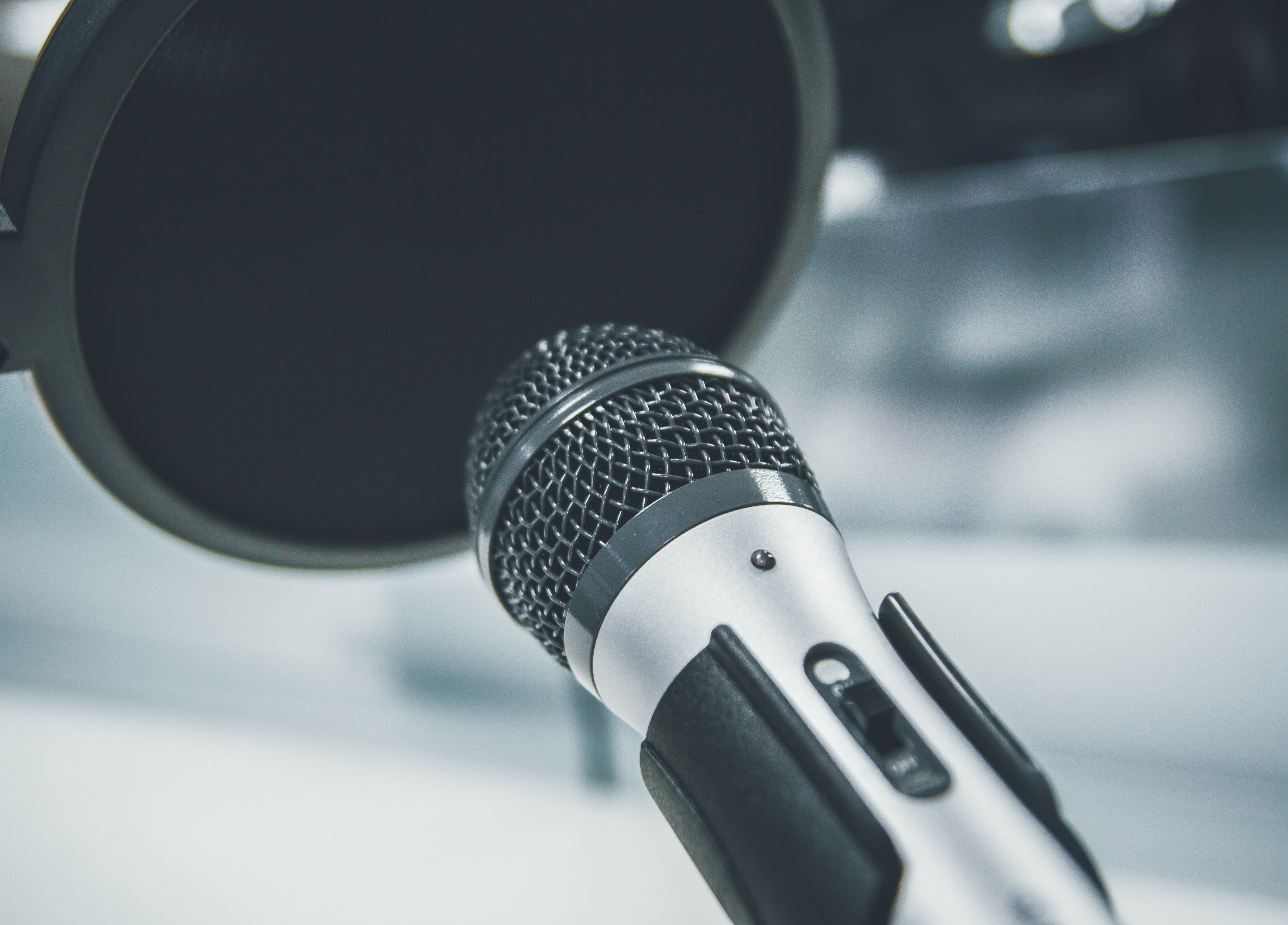 gray and black dynamic microphone with filter