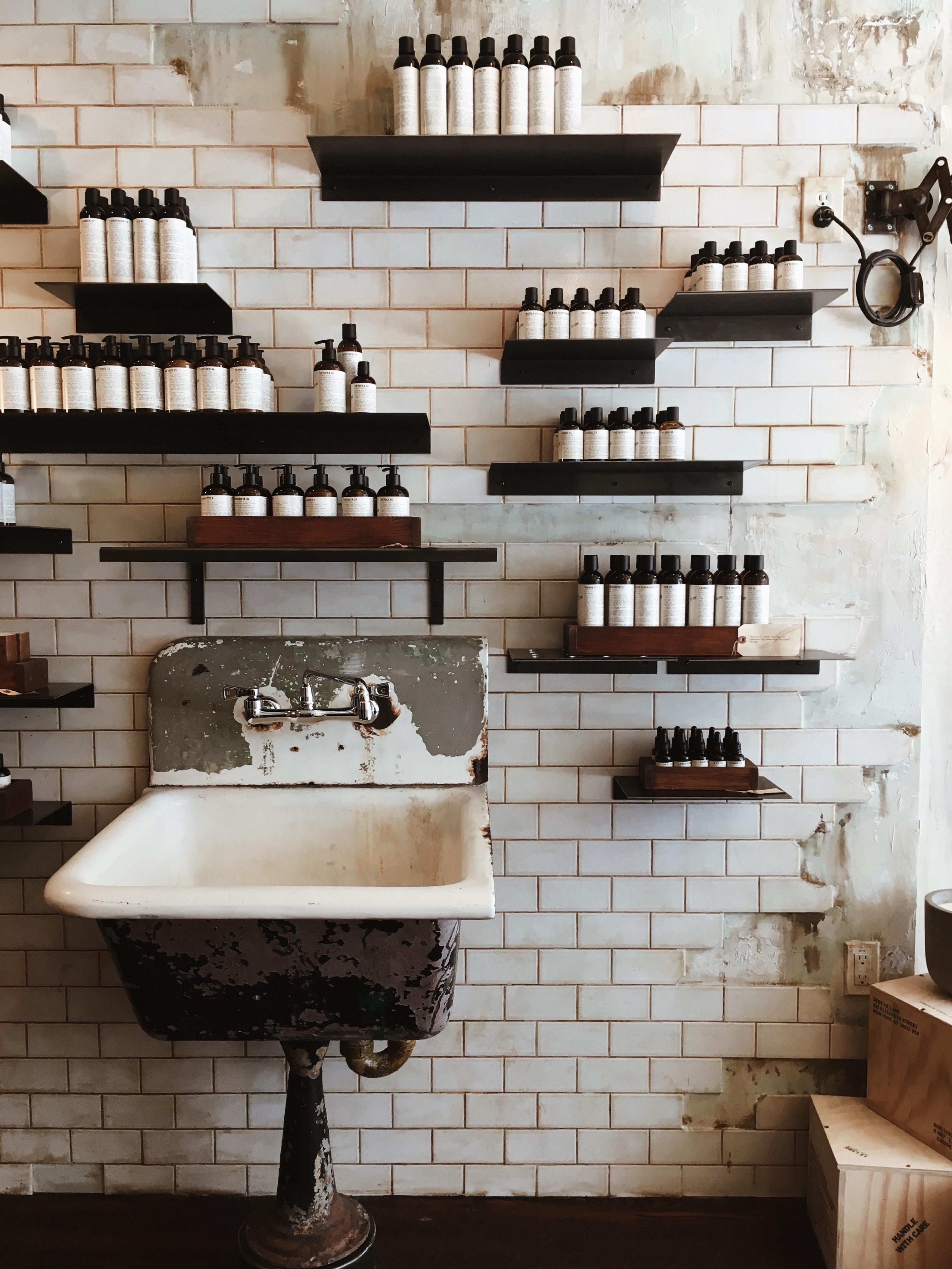 bottles on wall shelves above sink