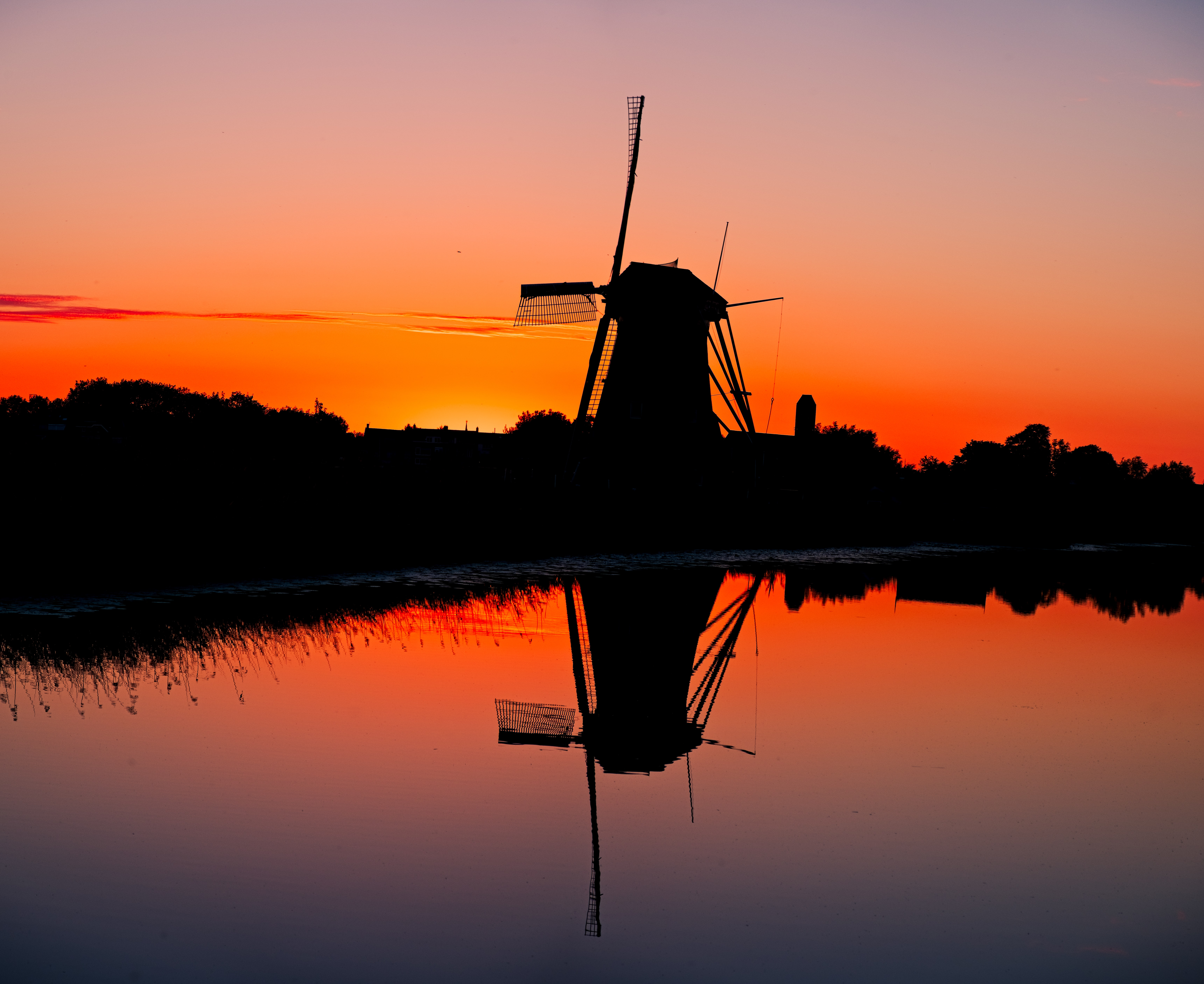 silhouette of water mill