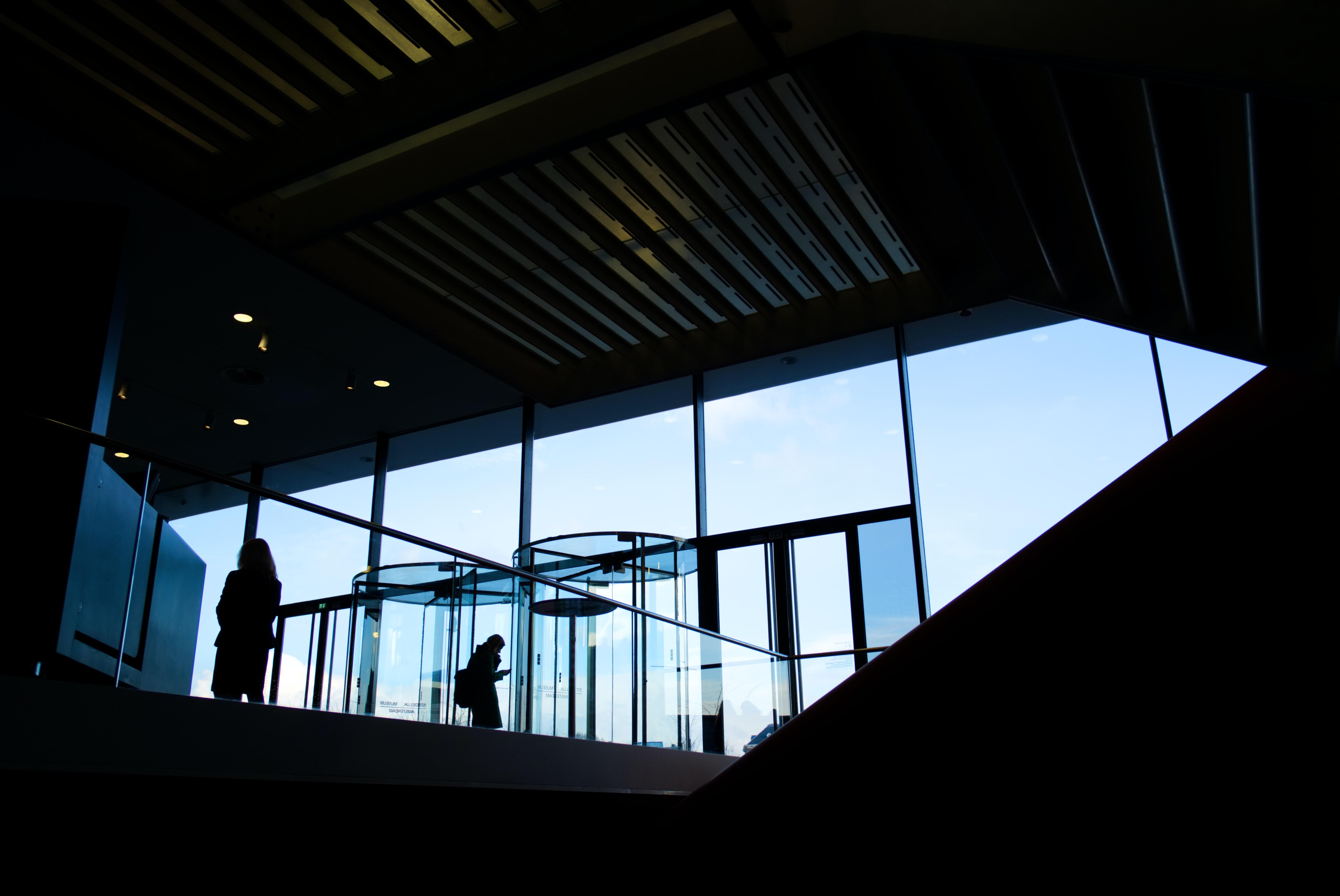 silhouette of person near windows