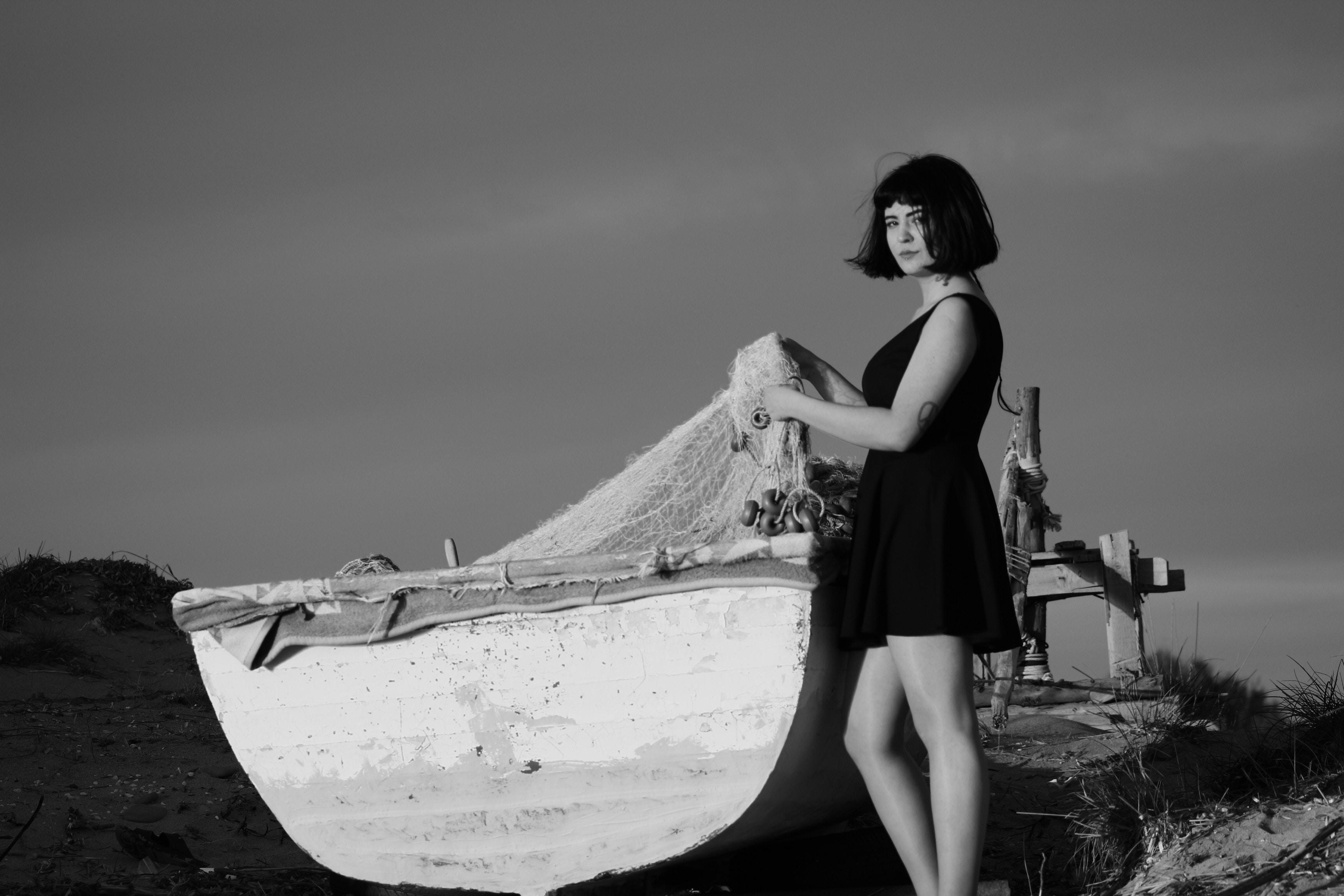grayscale photo of woman holding fish net