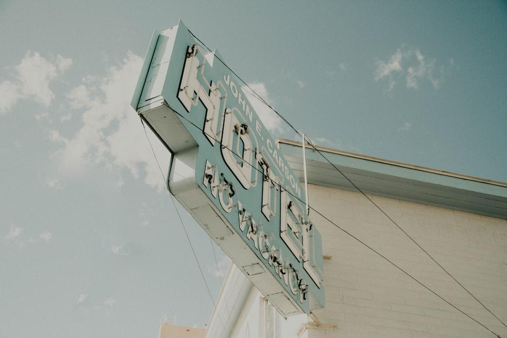 Hotel signage mounted on white building