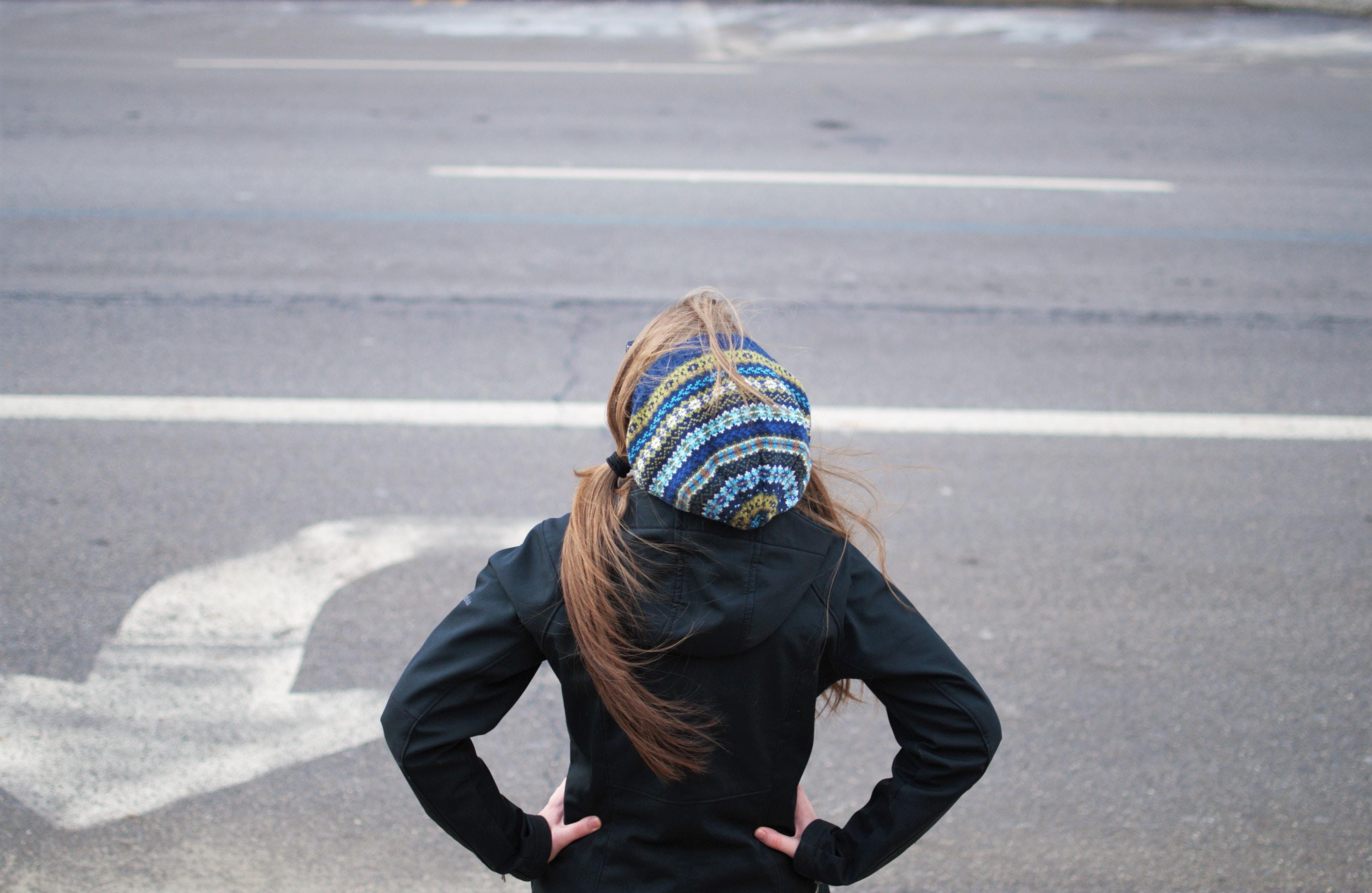 woman standing near road