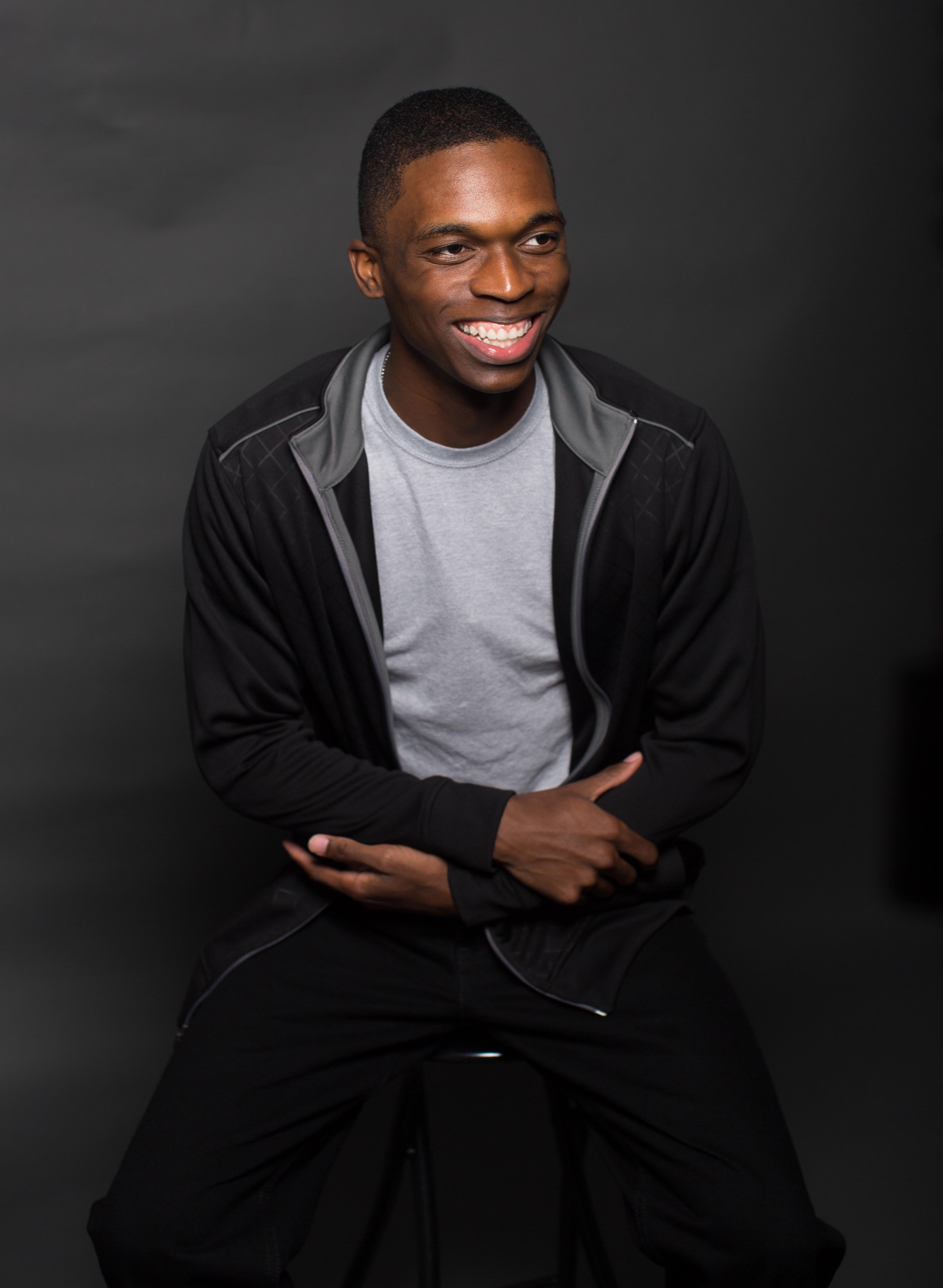 smiling man posing for photo