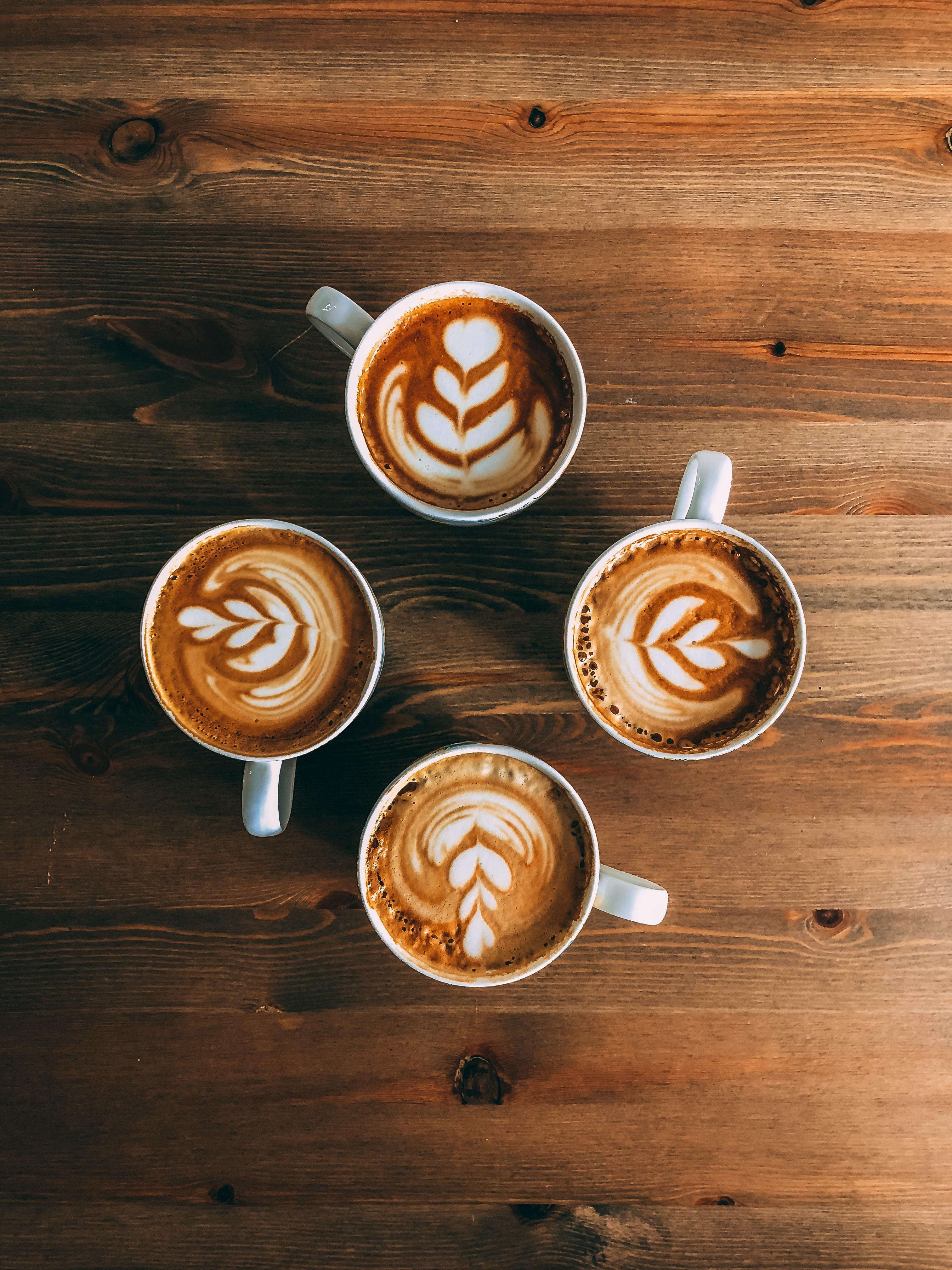 four mugs of latte arts