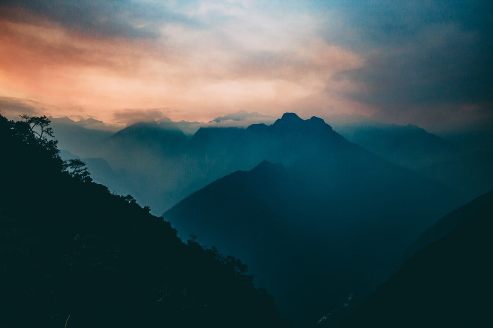 bird's eye view of mountain with fog