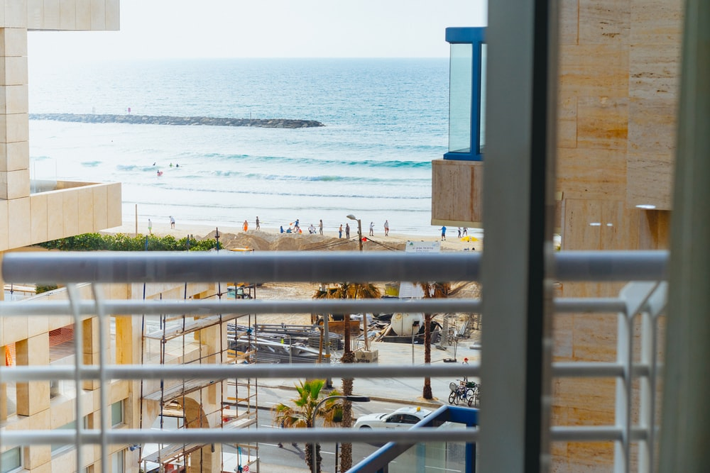 view of beach from porch during daytime