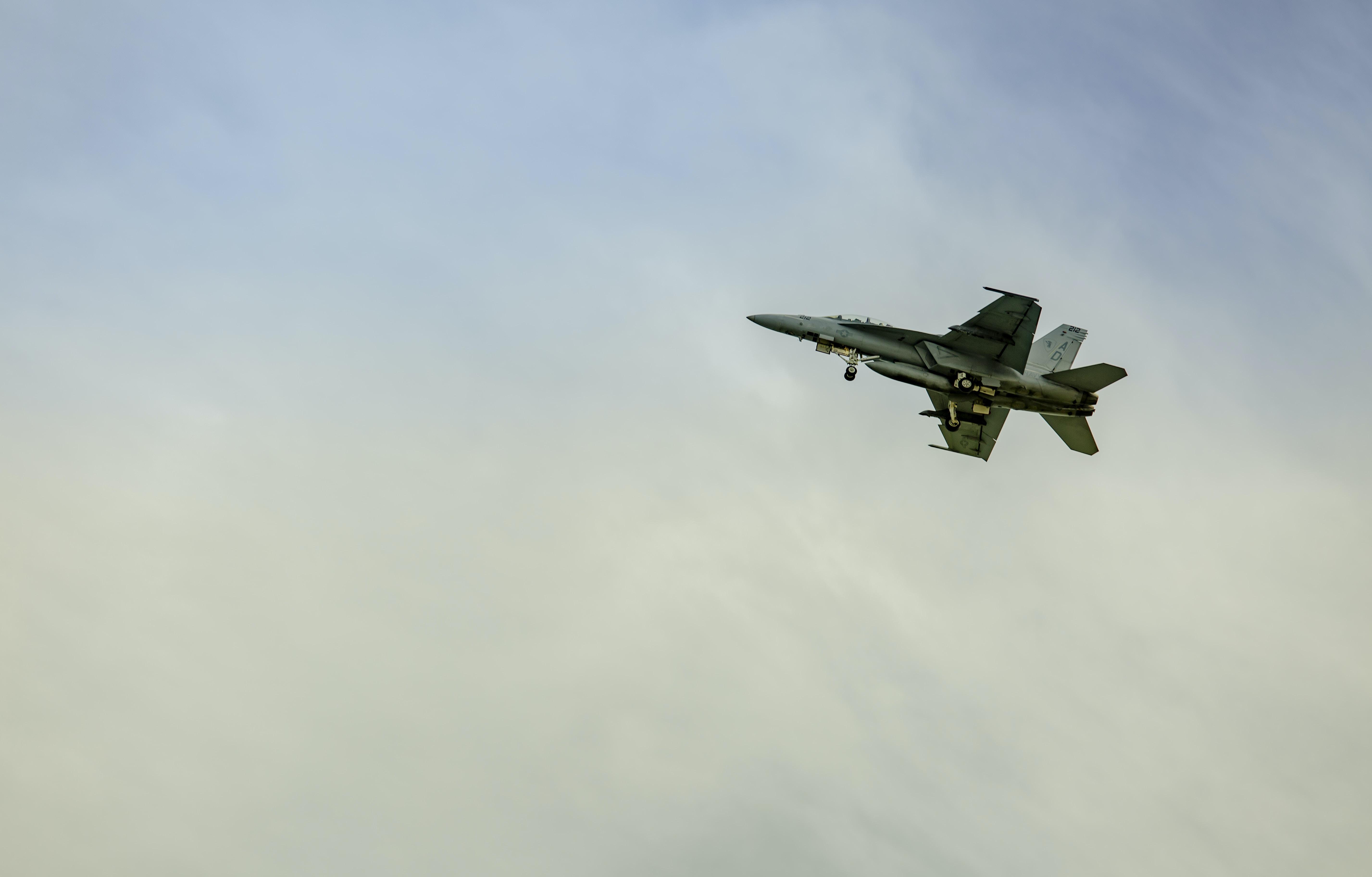 gray jet fighter flying through sky