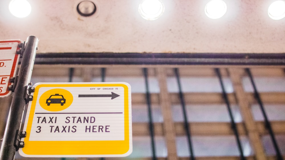 Taxi stand 3 taxis here sign