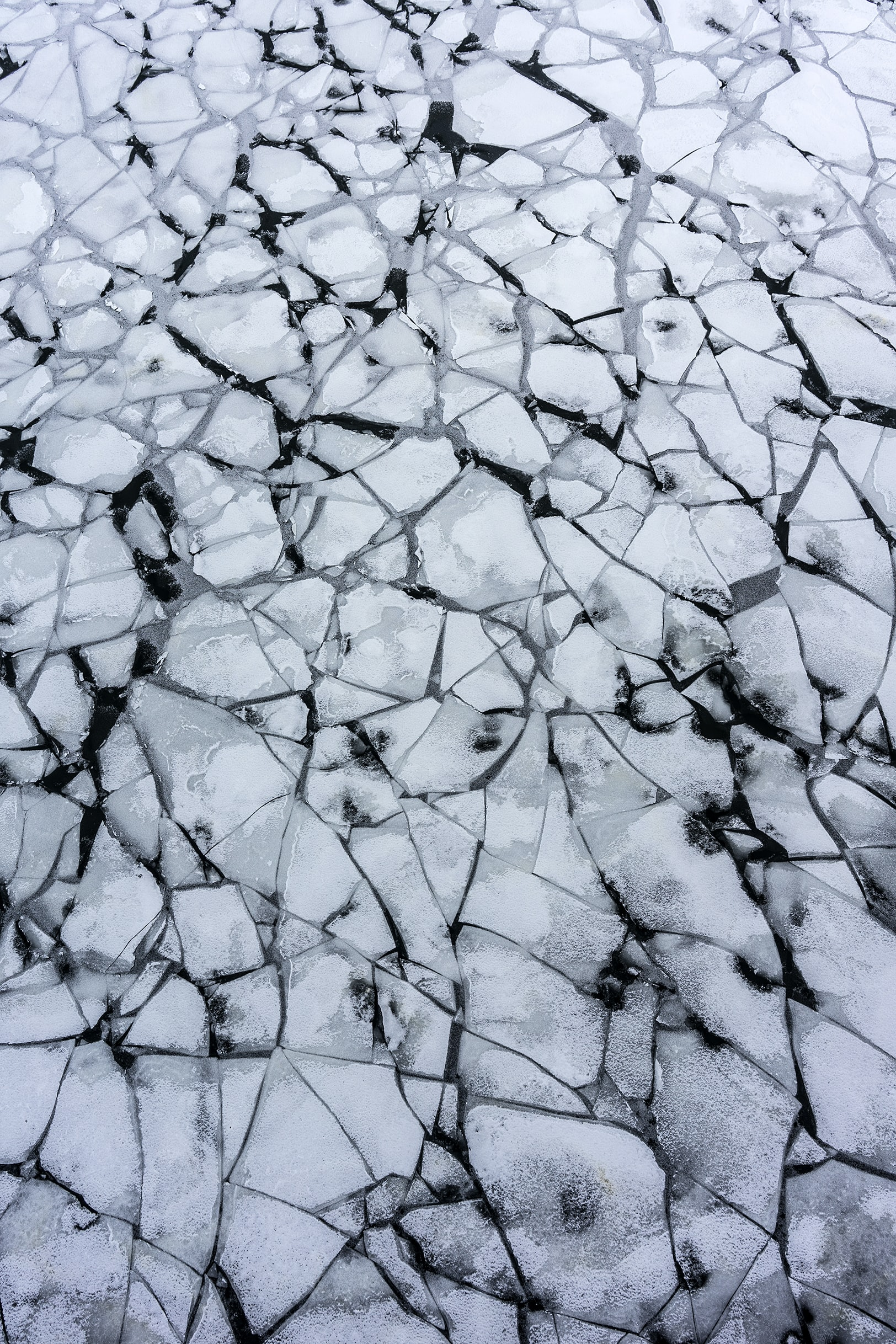 flat lay photography of shattered frosted river