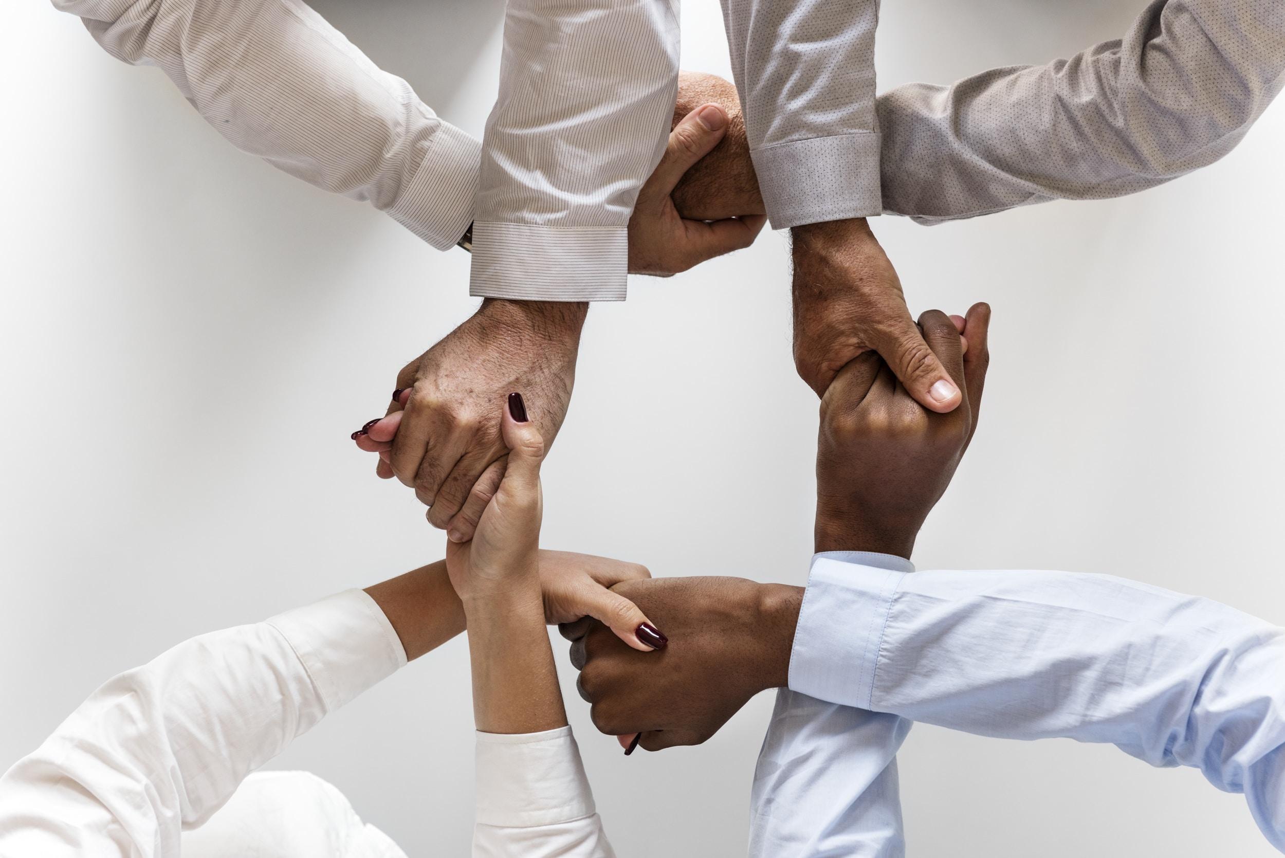 group of people hand gesture