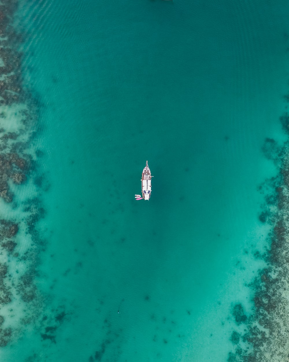 aerial view of boat on body of water at daytime