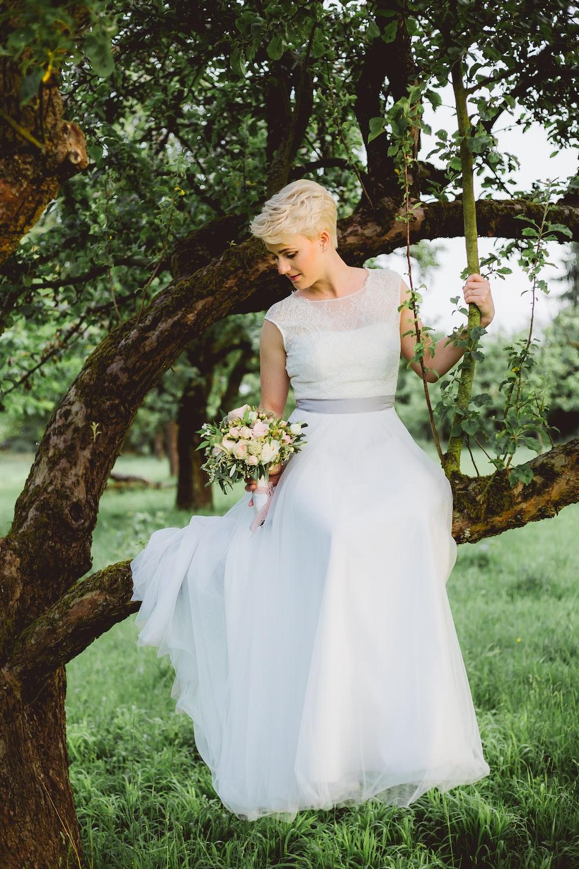 bride sitting on tree branch