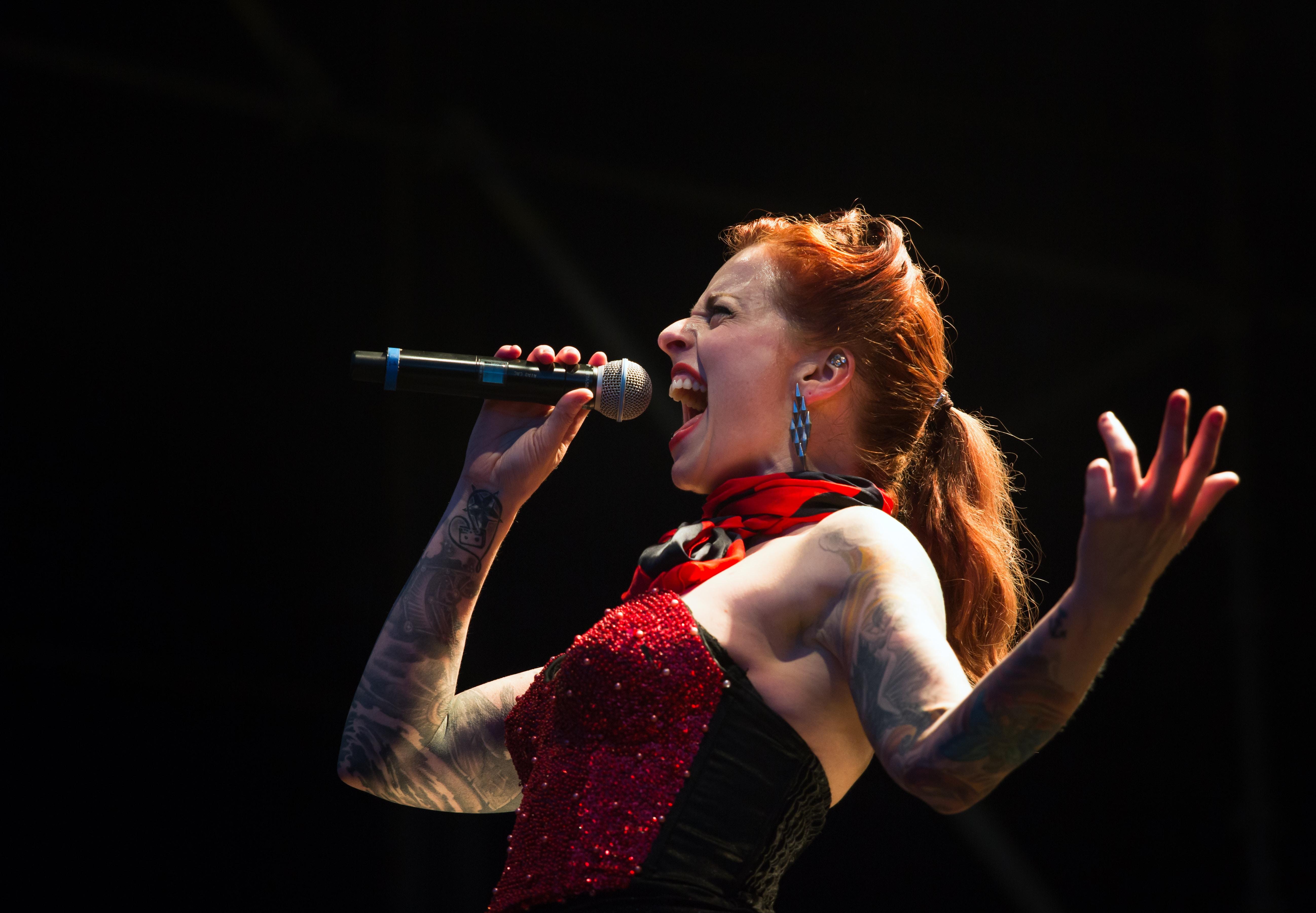 woman singing on wireless microphone
