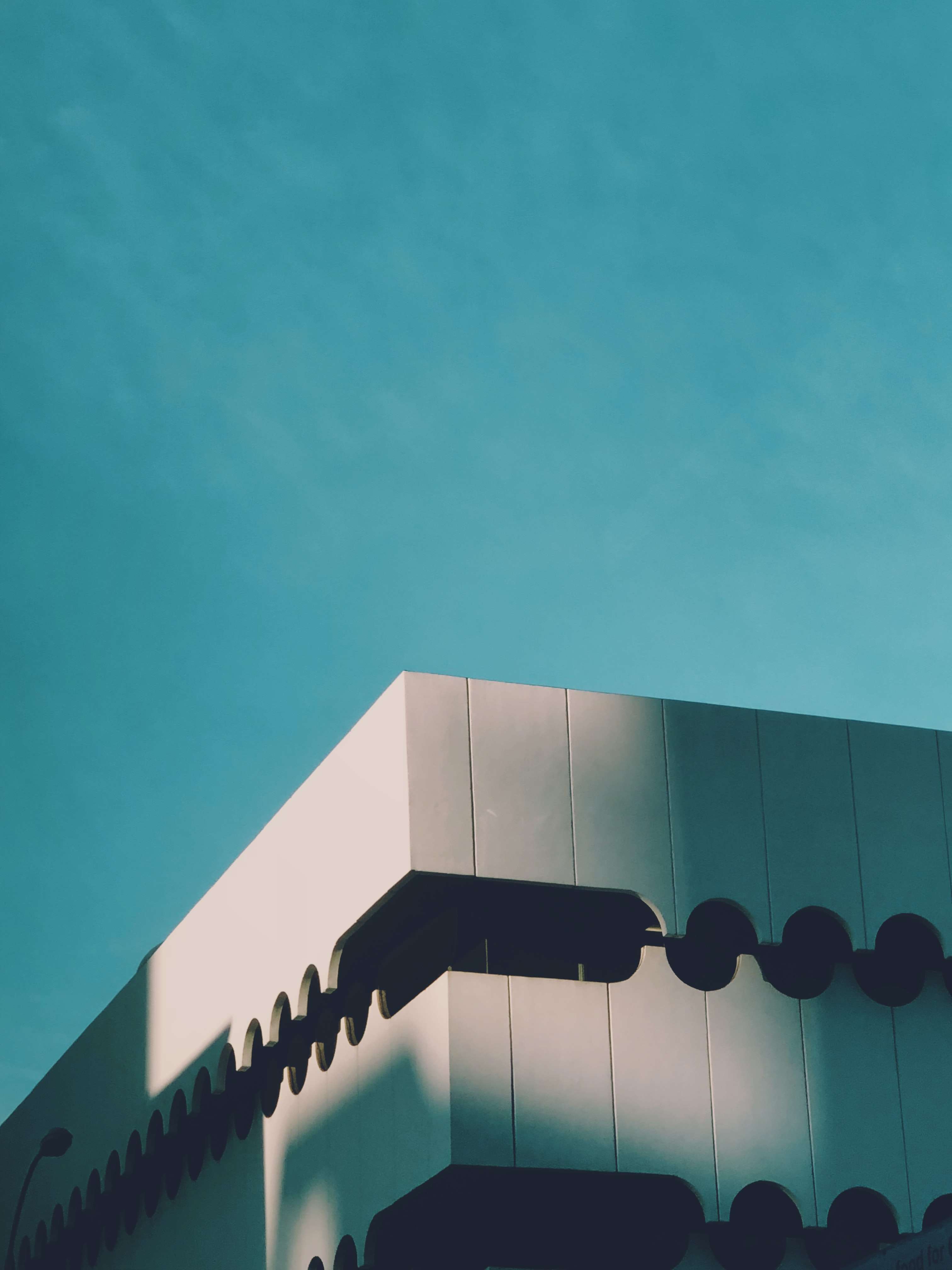 low-angle photography of building under blue sky during daytime