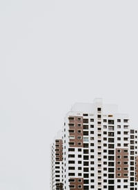 white and brown concrete high-rise building at daytime