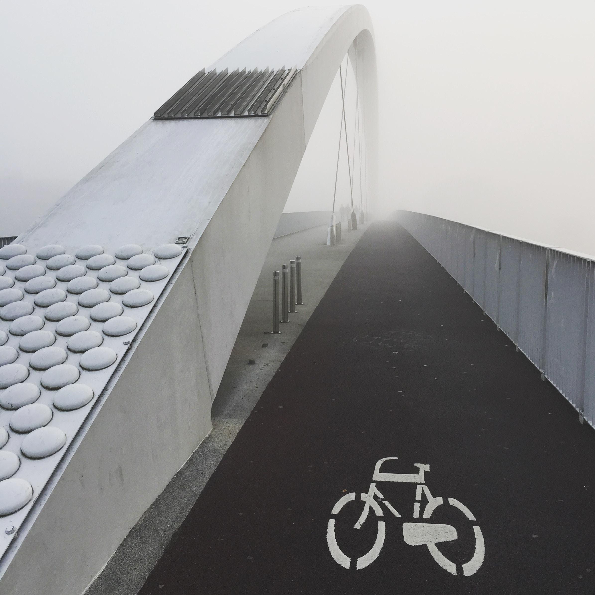 black bicycle lane on a bridge