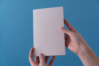 person holding Salt Water book