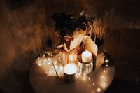 lighted candles on side table